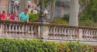 Family leaning on balustrade