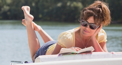Woman reading on boat