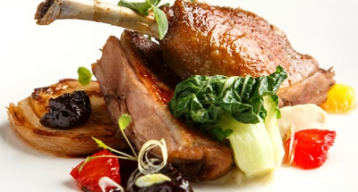 Duck confit with prune sauce