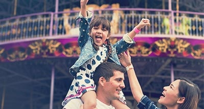 Child on father's shoulders