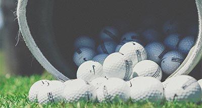 Golf Balls spilling from bag