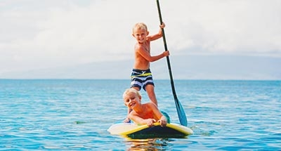 Two boys Paddleboarding