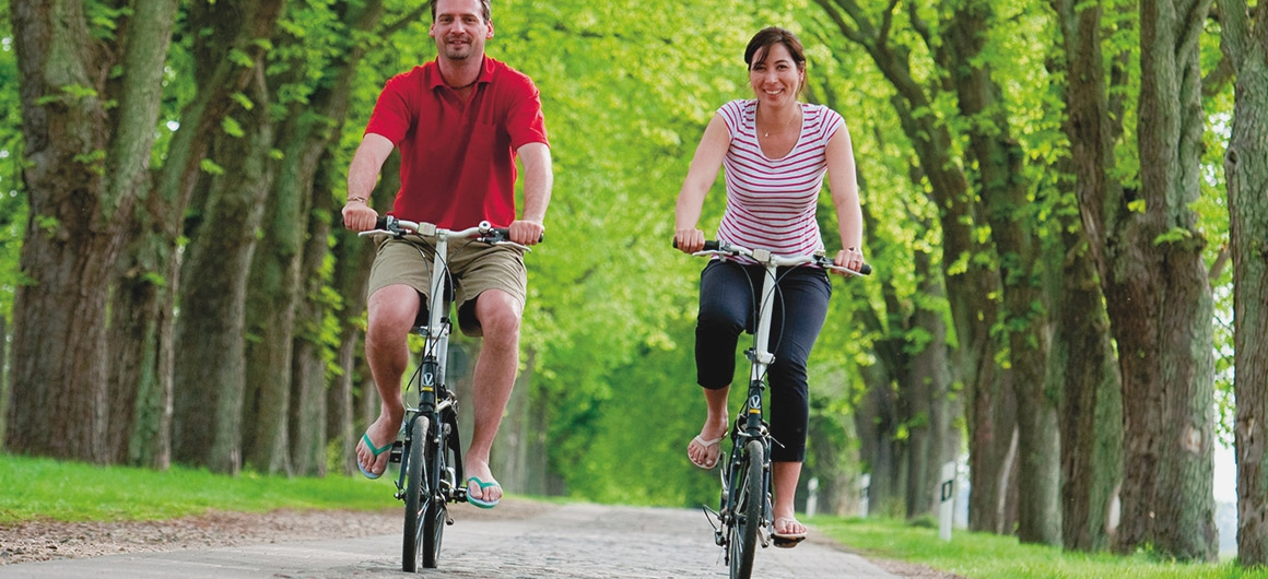 Couple cycling in Spreewald, Germany