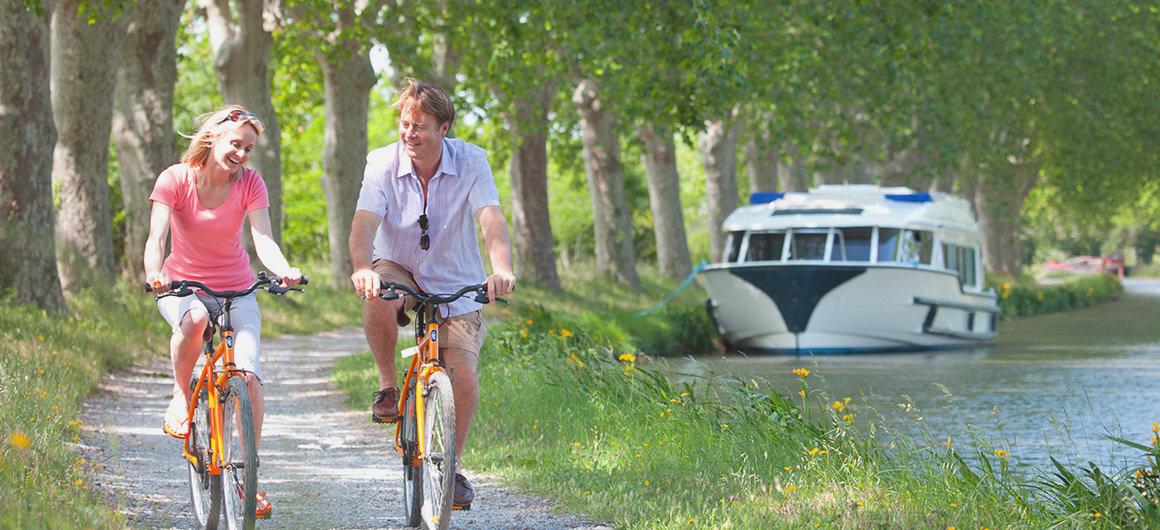 A couple cycling along a country lane