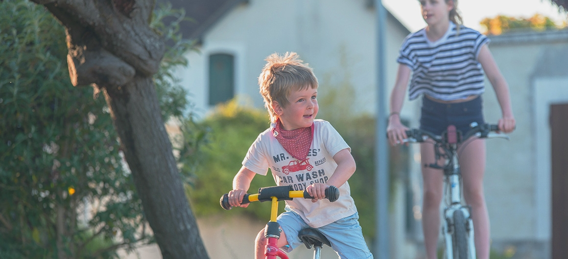 Children Cycling in Burgundy