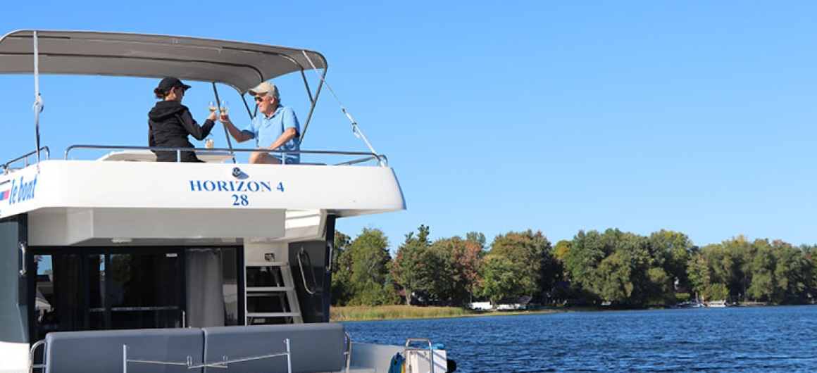 Sharing wine on the Rideau Canal on your Le Boat houseboat rental