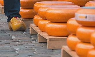 Stacked Gouda cheeses at the cheese market